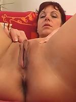 Mature hooker enjoying a deep dildo penetration