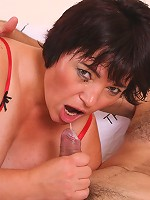 Hot older babe Anna sucking a huge cock in her red corset and net stockings