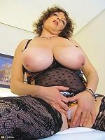 mature slut with the big boobies plays alone