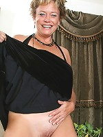 Mature and elegant Ariel strips off her black evening gown