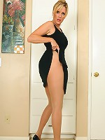 46 year old Jodi slips off her dress and poses in sexy nylons here