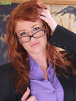 Redhead MILF Sara Orlando strips naked after getting home from work.